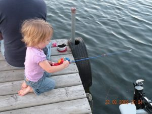 Girl fishing from resort dock
